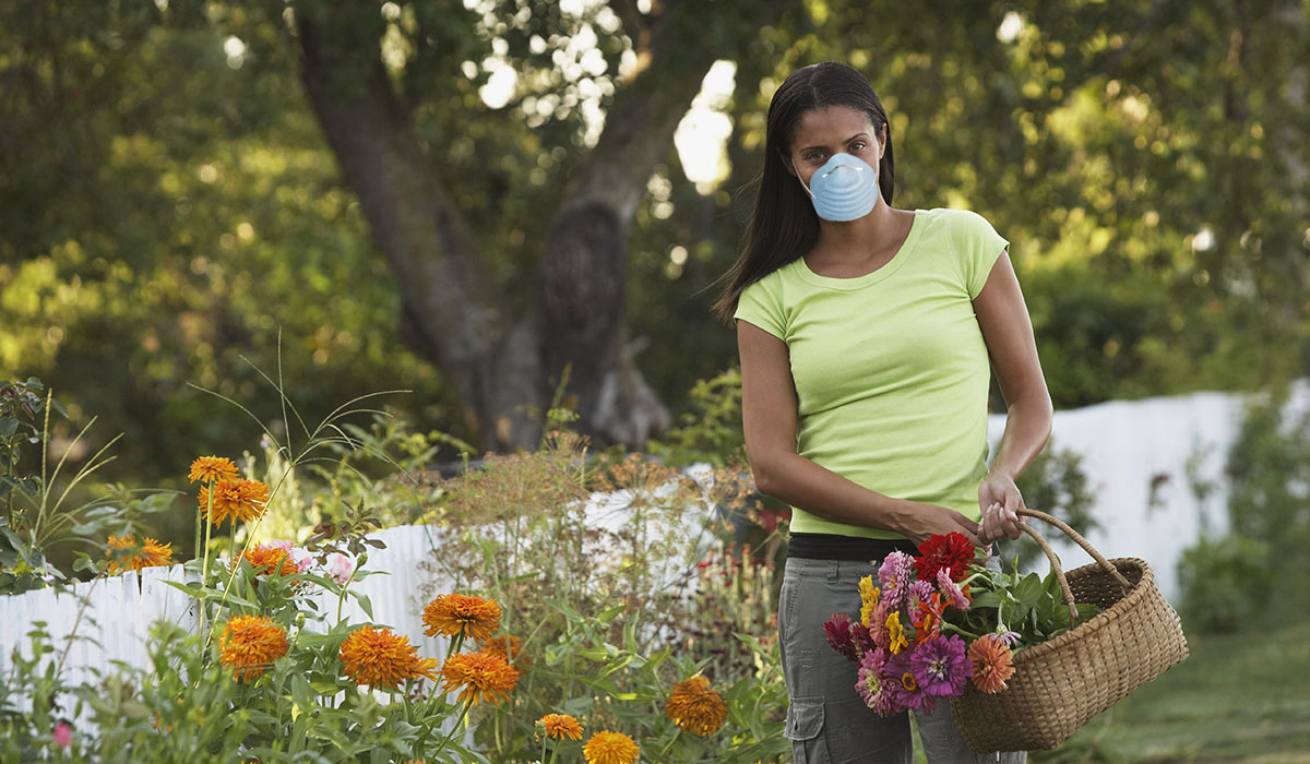Image of women in garden with face mask for allergy